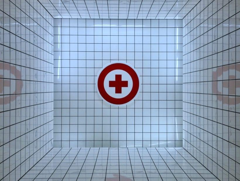 hospital cross on tiled wall