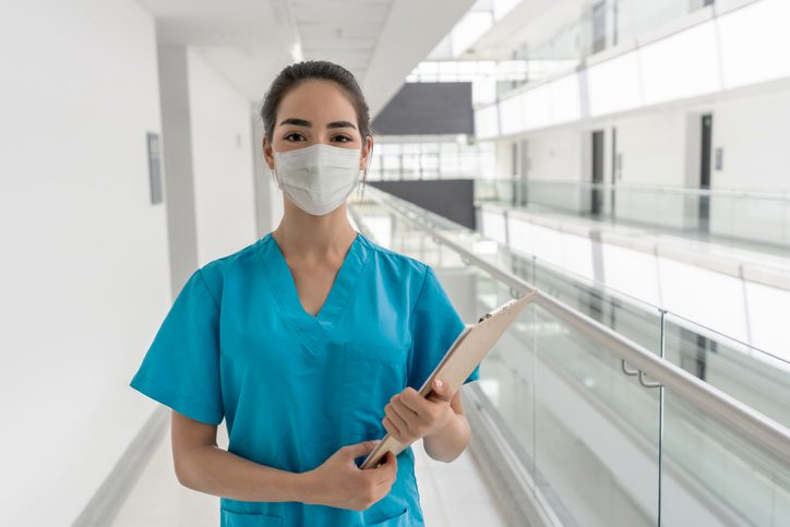 Happy nurse working at the hospital
